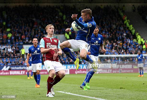 Jamie Vardy of Leicester City battles for the ball with Ben Mee of Burnley during the Barclays Premier League match between Burnley and Leicester...