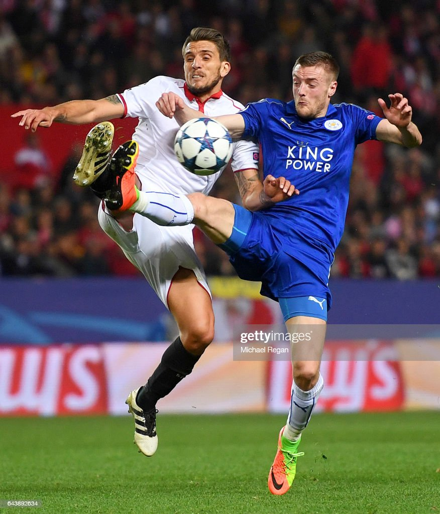 Jamie Vardy of Leicester City battles for the ball with Daniel Carrico of Sevilla during the UEFA Champions League Round of 16 first leg match between Sevilla FC and Leicester City at Estadio Ramon Sanchez Pizjuan on February 22, 2017 in Seville, Spain.