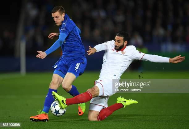 Jamie Vardy of Leicester City battles with Adil Rami of Savilla FC during the UEFA Champions League Round of 16 second leg match between Leicester...
