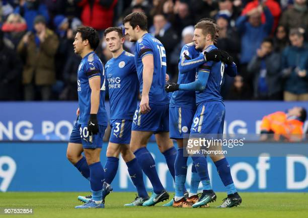 Jamie Vardy of Leicester City celebrates after scoring his sides first goal with his Leicester City team mates during the Premier League match...