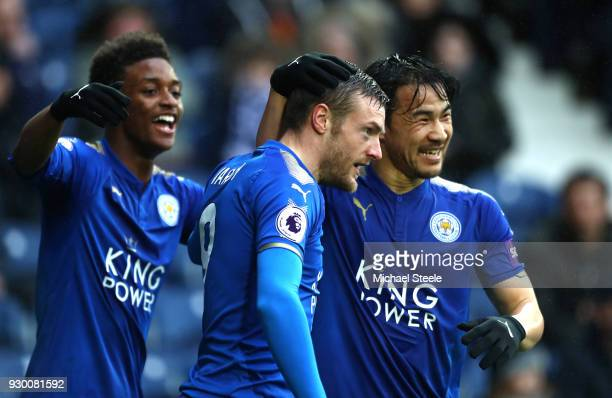 Jamie Vardy of Leicester City celebrates after scoring his sides first goal with Shinji Okazaki of Leicester City and Demarai Gray of Leicester City...