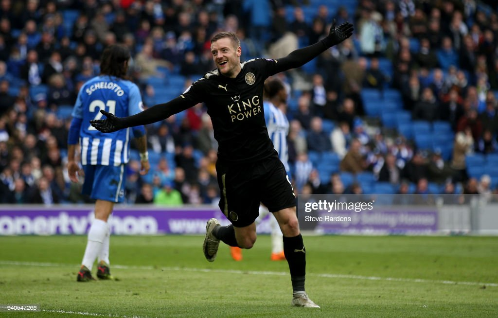 Jamie Vardy of Leicester City celebrates after scoring his sides second goal during the Premier League match between Brighton and Hove Albion and Leicester City at Amex Stadium on March 31, 2018 in Brighton, England.