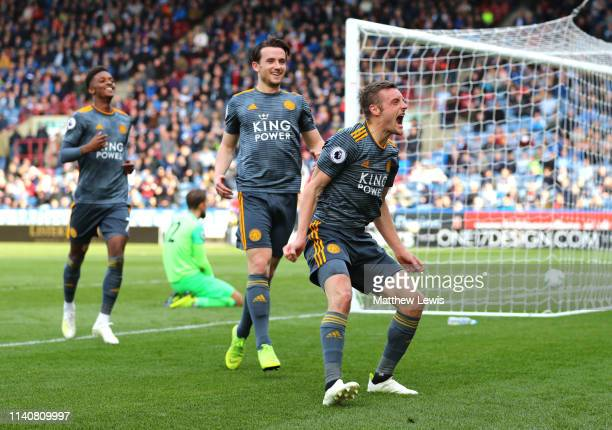 Jamie Vardy of Leicester City celebrates after scoring his team's fourth goal with his team mates during the Premier League match between...