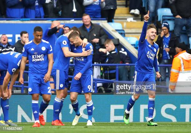 Jamie Vardy of Leicester City celebrates after scoring his team's second goal with team mates during the Premier League match between Leicester City...