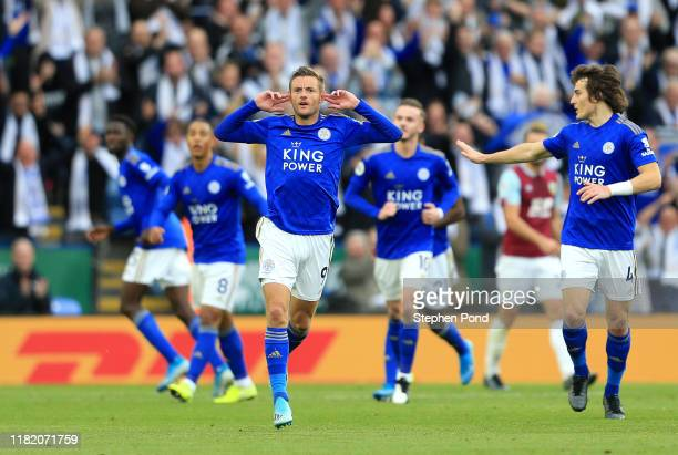 Jamie Vardy of Leicester City celebrates after scoring his team's first goal during the Premier League match between Leicester City and Burnley FC at...