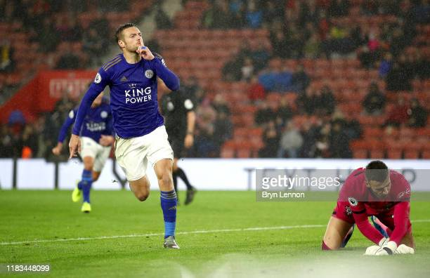 Jamie Vardy of Leicester City celebrates after scoring his team's ninth goal from the penalty spot as Angus Gunn of Southampton reacts during the...