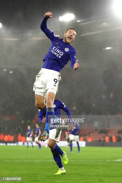 Jamie Vardy of Leicester City celebrates after scoring his team's ninth goal from the penalty spot during the Premier League match between...