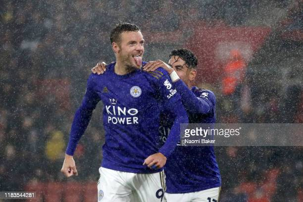 Jamie Vardy of Leicester City celebrates after scoring his team's fifth goal with Ayoze Perez of Leicester City during the Premier League match...