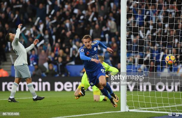 Jamie Vardy of Leicester City celebrates after scoring the first goal during the Premier League match between Leicester City and Everton at The King...