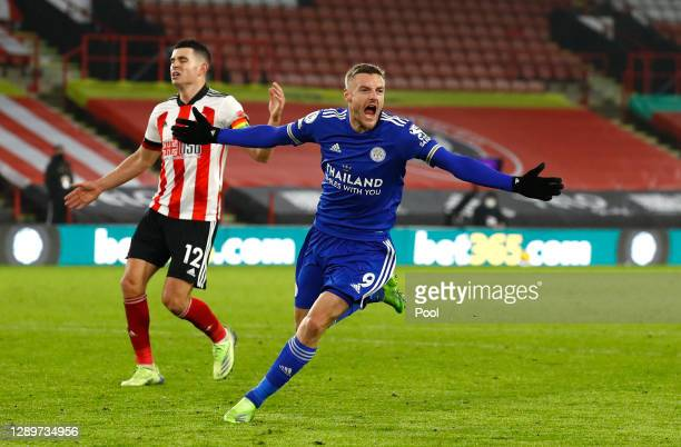 Jamie Vardy of Leicester City celebrates after scoring their sides second goal as John Egan of Sheffield United looks dejected during the Premier...