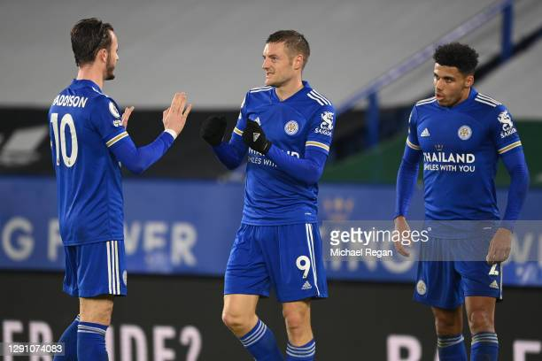 Jamie Vardy of Leicester City celebrates after scoring their team's second goal with teammates James Maddison and James Justin during the Premier...