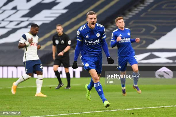 Jamie Vardy of Leicester City celebrates after scoring their team's first goal from a penalty during the Premier League match between Tottenham...