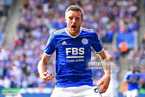 Jamie Vardy of Leicester City celebrates after scoring their team's first goal during the Premier League match between Leicester City and Burnley at...