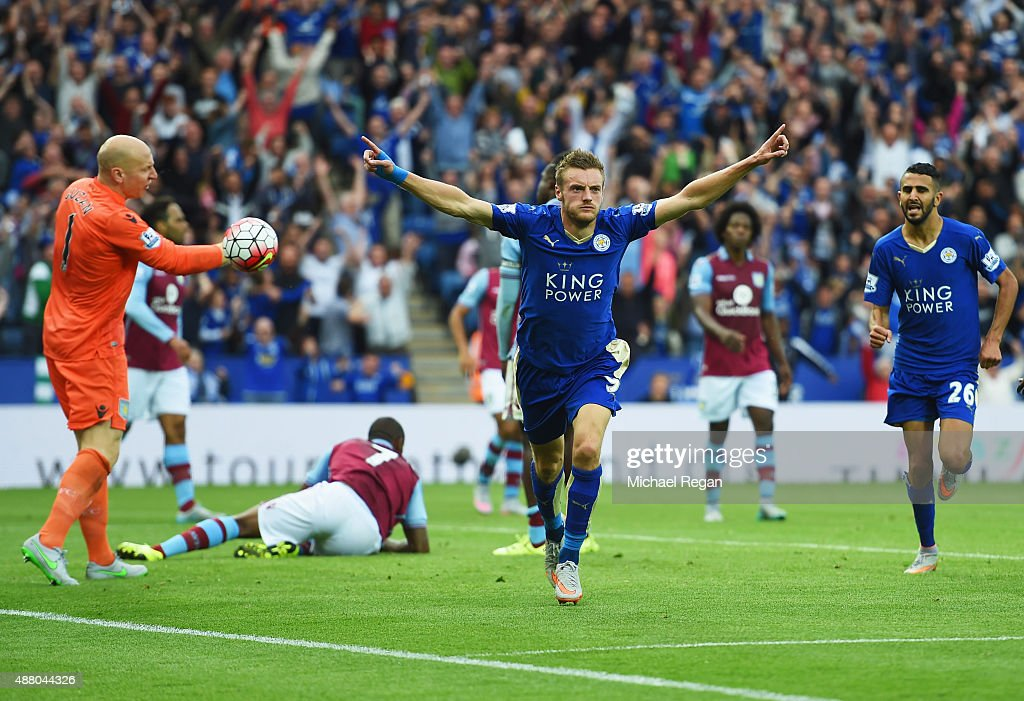 Jamie Vardy of Leicester City (9) celebrates as he scores their second and equalising goal as goalkeeper Brad Guzan of Aston Villa (L) reacts during the Barclays Premier League match between Leicester City and Aston Villa at the King Power Stadium on September 13, 2015 in Leicester, United Kingdom.