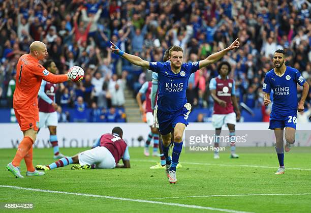 Jamie Vardy of Leicester City celebrates as he scores their second and equalising goal as goalkeeper Brad Guzan of Aston Villa reacts during the...