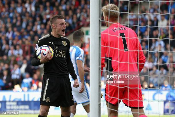 Jamie Vardy of Leicester City celebrates scoring his sides first goal during the Premier League match between Huddersfield Town and Leicester City at...