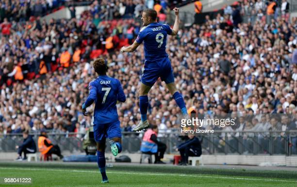 Jamie Vardy of Leicester City celebrates scoring his sides first goal with team mate Demarai Gray of Leicester City during the Premier League match...