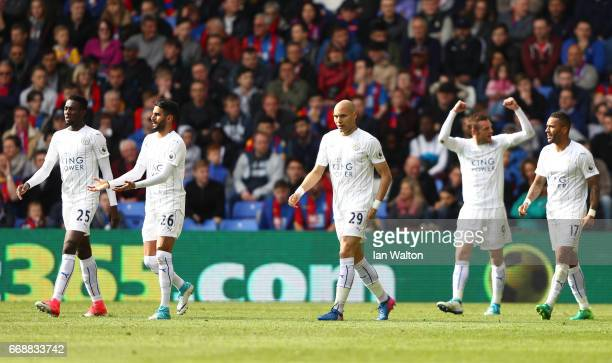 Jamie Vardy of Leicester City celebrates scoring his sides second goal with team mates during the Premier League match between Crystal Palace and...