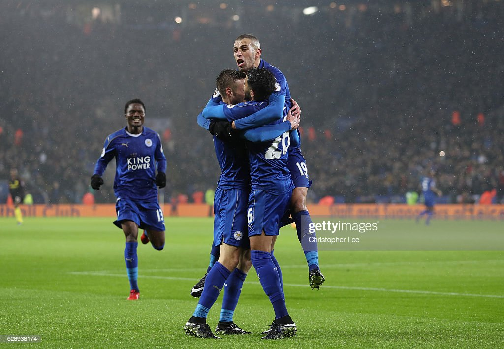 Jamie Vardy of Leicester City celebrates scoring his sides third goal with Islam Slimani of Leicester City (R) during the Premier League match between Leicester City and Manchester City at the King Power Stadium on December 10, 2016 in Leicester, England.
