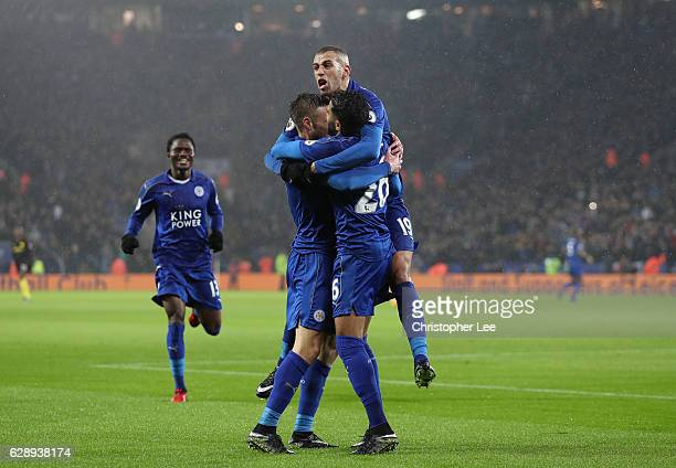 Jamie Vardy of Leicester City celebrates scoring his sides third goal with Islam Slimani of Leicester City during the Premier League match between...