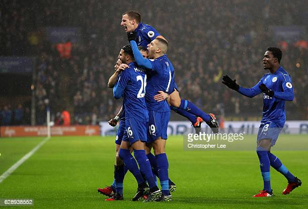 Jamie Vardy of Leicester City celebrates scoring his sides third goal with his Leicester City team mates during the Premier League match between...