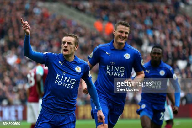 Jamie Vardy of Leicester City celebrates scoring his sides third goal with Robert Huth of Leicester City during the Premier League match between West...