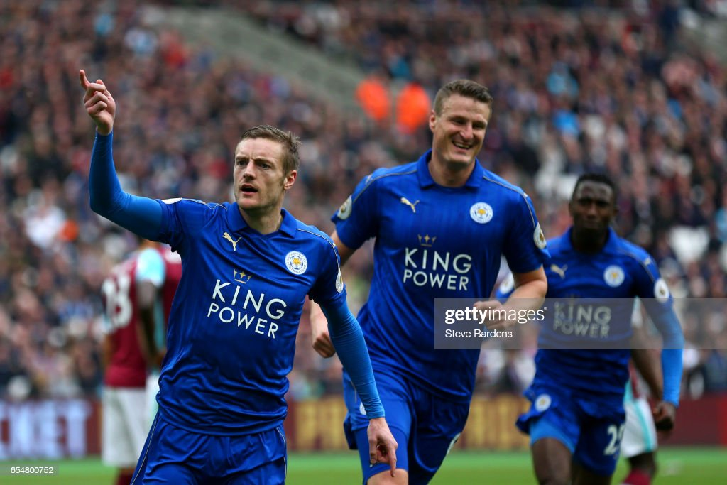 Jamie Vardy of Leicester City (L) celebrates scoring his sides third goal with Robert Huth of Leicester City (R) during the Premier League match between West Ham United and Leicester City at London Stadium on March 18, 2017 in Stratford, England.