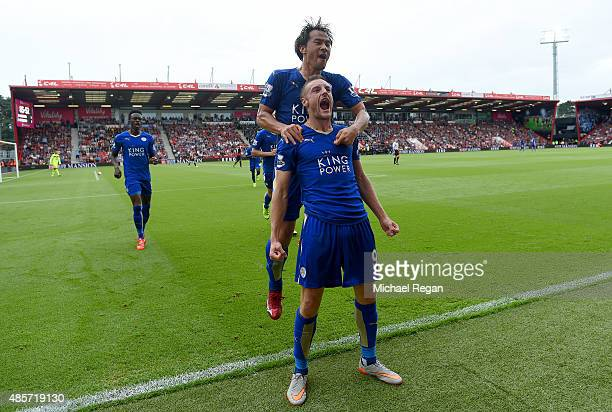 Jamie Vardy of Leicester City celebrates scoring his team's first goal with his team mate Shinji Okazaki during the Barclays Premier League match...