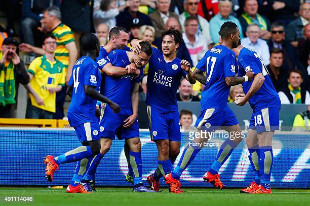 Jamie Vardy of Leicester City celebrates scoring his team's first goal with his team mates during the Barclays Premier League match between Norwich...