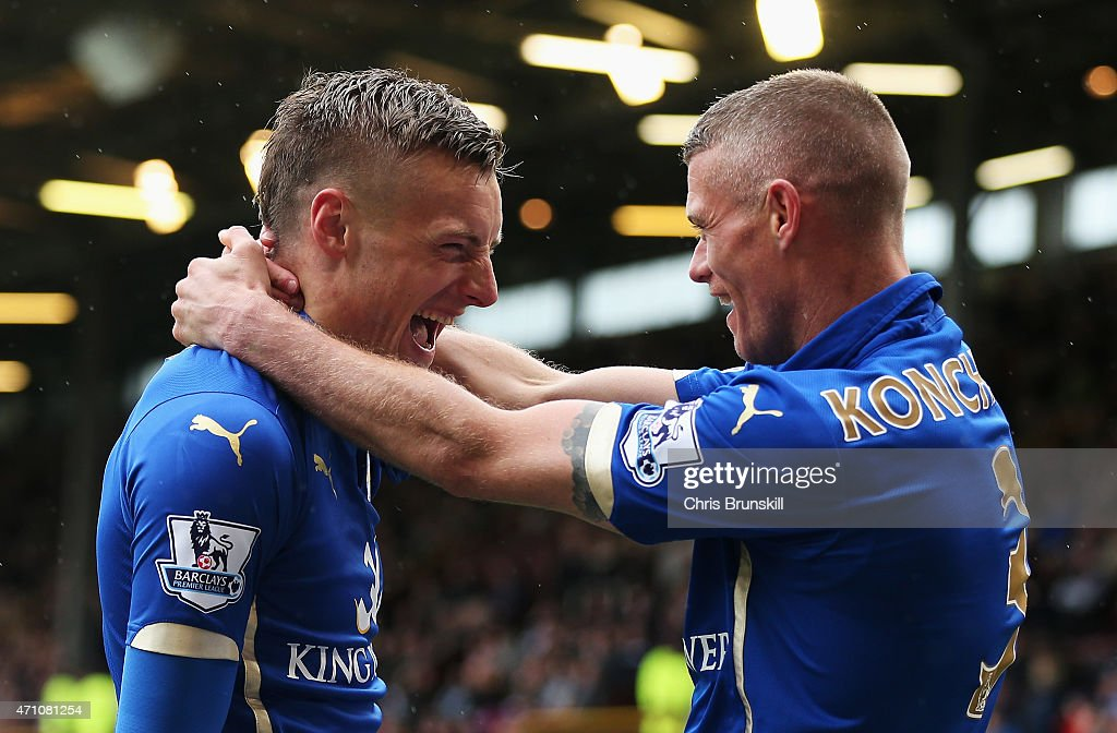 Jamie Vardy of Leicester City (L) celebrates scoring their first goal with Paul Konchesky of Leicester City during the Barclays Premier League match between Burnley and Leicester City at Turf Moor on April 25, 2015 in Burnley, England.
