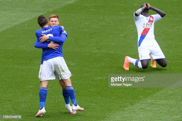 Jamie Vardy of Leicester City celebrates with Harvey Barnes after scoring his team's second goal as Mamadou Sakho of Crystal Palace reacts during the...