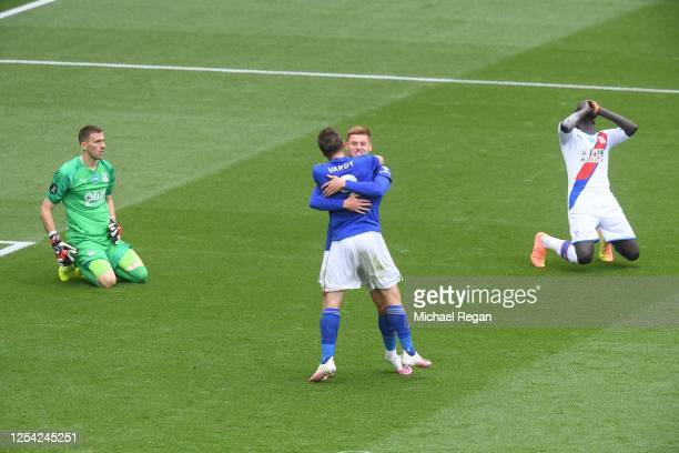 Jamie Vardy of Leicester City celebrates with Harvey Barnes after scoring his team's second goal as Mamadou Sakho and Vicente Guaita of Crystal...