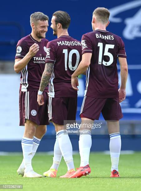 Jamie Vardy of Leicester City celebrates with James Maddison and Harvey Barnes after scoring his team's third goal during the Premier League match...