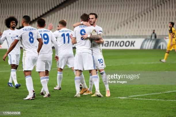 Jamie Vardy of Leicester City celebrates with James Maddison of Leicester City and his team mates after scoring from the penalty spot to make it 01...