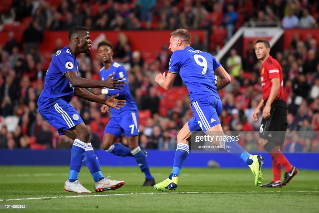Jamie Vardy of Leicester City celebrates with Kelechi Iheanacho of Leicester City after he scored their second goal during the Premier League match between Manchester United and Leicester City at Old Trafford on August 10, 2018 in Manchester, United Kingdom.