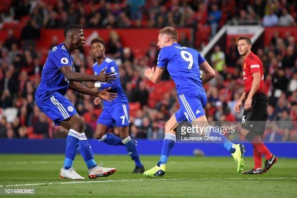 Jamie Vardy of Leicester City celebrates with Kelechi Iheanacho of Leicester City after he scored their second goal during the Premier League match...