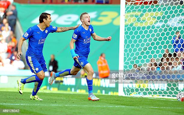 Jamie Vardy of Leicester City celebrates with Leonardo Ulloa of Leicester City after scoring to make it 22 during the Premier League match between...