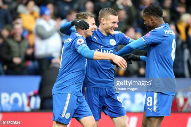 Jamie Vardy of Leicester City celebrates with Marc Albrighton and Kelechi Iheanacho of Leicester City after scoring to make it 10 during the Premier...