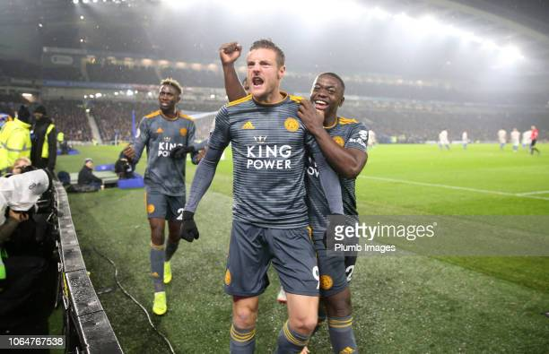 Jamie Vardy of Leicester City celebrates with Nampalys Mendy of Leicester City after scoring from the penalty spot to make it 1-1 during the Premier...
