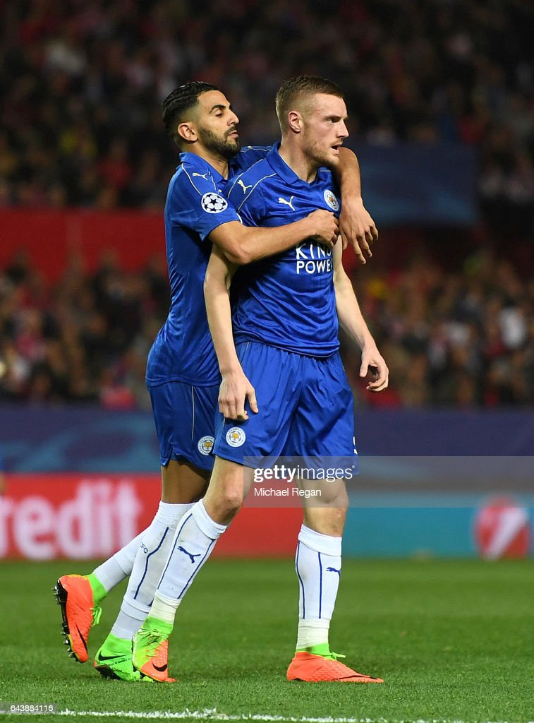 Jamie Vardy of Leicester City celebrates with Riyad Mahrez after scoring his side's first goal during the UEFA Champions League Round of 16 first leg match between Sevilla FC and Leicester City at Estadio Ramon Sanchez Pizjuan on February 22, 2017 in Seville, Spain.