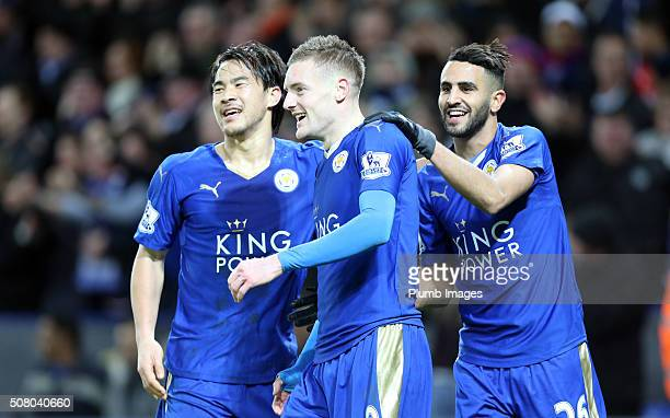 Jamie Vardy of Leicester City celebrates with Shinji Okazaki and Riyad Mahrez of Leicester City after scoring to make it 20 during the Barclays...