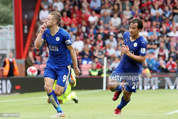 Jamie Vardy of Leicester City celebrates with Shinji Okazaki of Leicester City after scoring from the penalty spot to make it 11 during the Premier...