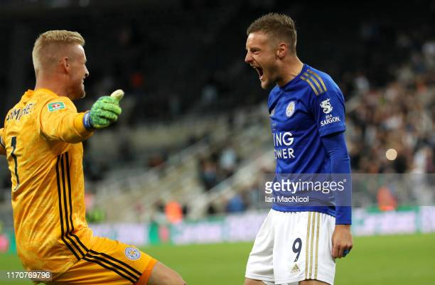 Jamie Vardy of Leicester City celebrates with team mate Kasper Schmeichel after scoring their winning penalty during the Carabao Cup Second Round...