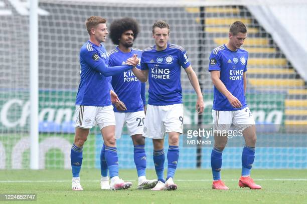 Jamie Vardy of Leicester City celebrates with team mates after scoring his sides second goal and his sides third during the Premier League match...