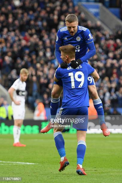 Jamie Vardy of Leicester City celebrates with teammate Harvey Barnes after scoring his team's third goal during the Premier League match between...