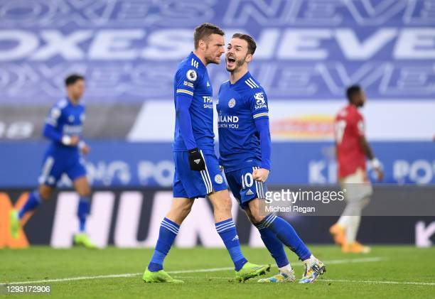 Jamie Vardy of Leicester City celebrates with teammate James Maddison after Axel Tuanzebe of Manchester United scored an own goal during the Premier...