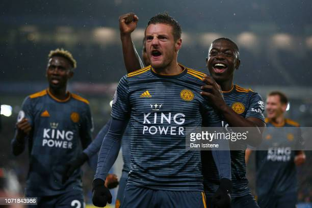 Jamie Vardy of Leicester City celebrates with teammates after scoring his team's first goal from the penalty spot during the Premier League match...