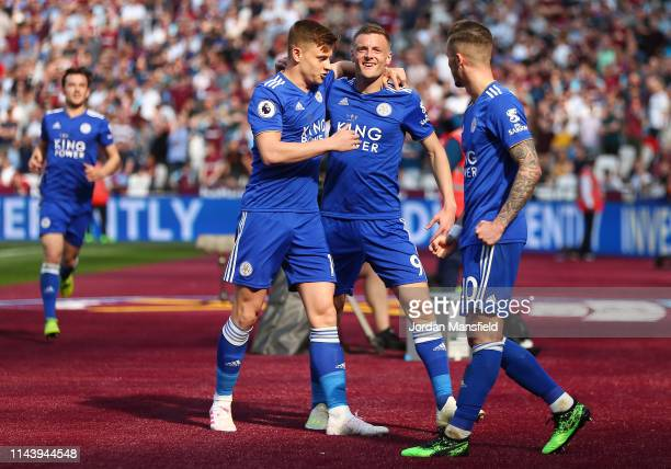 Jamie Vardy of Leicester City celebrates with teammates after scoring his team's first goal during the Premier League match between West Ham United...