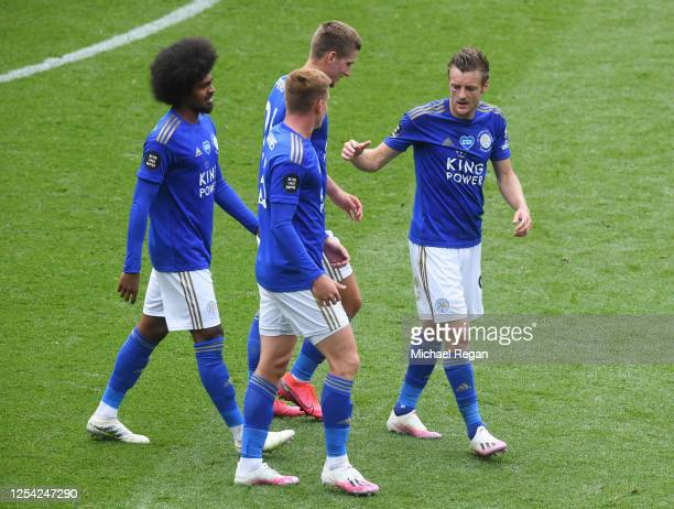 Jamie Vardy of Leicester City celebrates with teammates after scoring his team's third goal during the Premier League match between Leicester City...