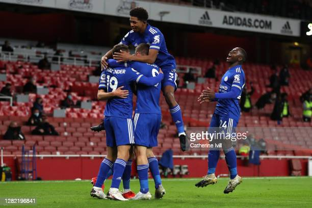 Jamie Vardy of Leicester City celebrates with teammates after scoring his team's first goal during the Premier League match between Arsenal and...